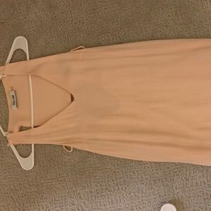 Light pink summer dress with back cut out.